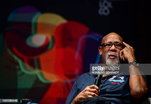 Former US track and field athlete and professional football player John Carlos speaks during a conference at the National University in Mexico City,...