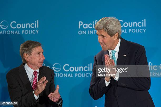 "Former U.S. Trade Ambassador Michael ""Mickey"" Kantor applauds as United States Secretary of State John Kerry arrives to address the Pacific Council..."