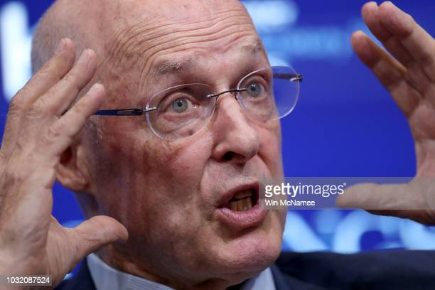 Former US Treasury Secretary Hank Paulson answers questions during a conference with former Federal Reserve Board Chairman Ben Bernanke and former US...