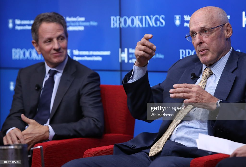 Former U.S. Treasury Secretary Hank Paulson (R) answers questions during a conference with former Federal Reserve Board Chairman Ben Bernanke and former U.S. Treasury Secretary Timothy Geithner (L) at the Brookings Institution September 12, 2018 in Washington, DC. The three participated in a conference on 'Responding to the Global Financial Crisis: What We Did and Why We Did It.'