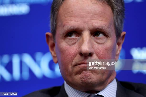 Former US Treasury Secretary Timothy Geithner attends a conference with former Federal Reserve Board Chairman Ben Bernanke and former US Treasury...