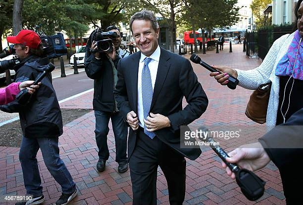 Former US Treasury Secretary Timothy Geithner walks to the US Court of Federal Claims October 7 2014 in Washington DC Geithner will be a witness and...