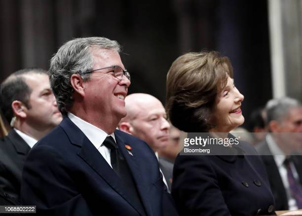 Former U.S. U.S. First Lady Laura Bush, right, and Jeb Bush, former governor of Florida, smile during a state funeral service for former President...