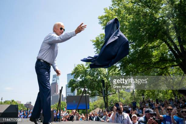 Former US Vice President and Democratic presidential candidate Joe Biden takes off his jacket as he takes the stage for a campaign kickoff rally May...