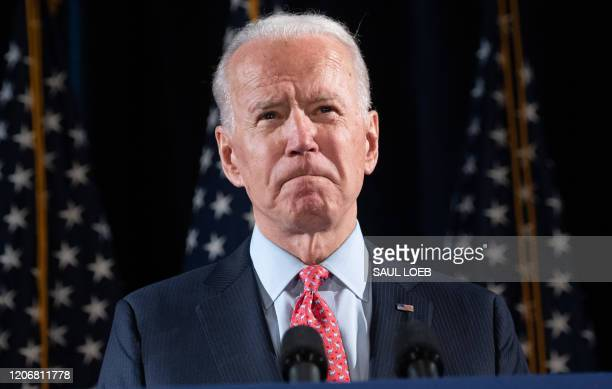 Former US Vice President and Democratic presidential hopeful Joe Biden speaks about COVID-19, known as the Coronavirus, during a press event in...