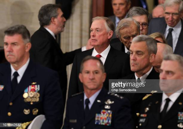 Former US Vice President Dan Quayle arrives at a memorial ceremony for former US President George HW Bush in the US Capitol Rotunda December 03 2018...