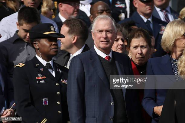 Former US Vice President Dan Quayle attends a Veterans Day event at the Tomb of the Unknown Soldier at Arlington National Cemetery on November 11...