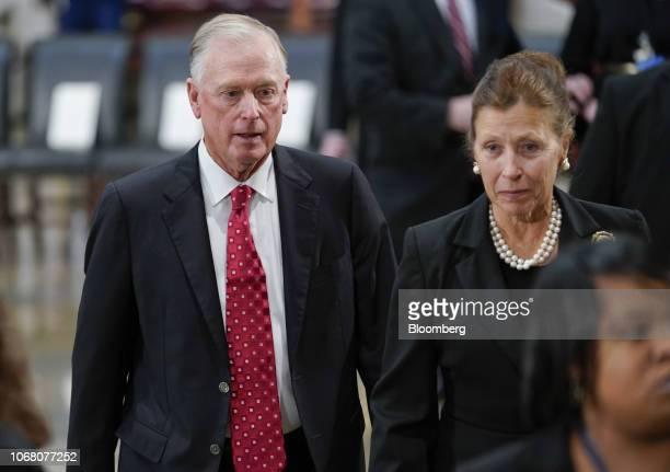 former US Vice President Dan Quayle left and former US Second Lady Marilyn Quayle arrive for a memorial service for former US President George HW...