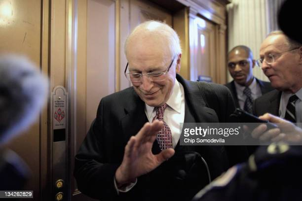 Former US Vice President Dick Cheney refuses to answer press questions as he leaves the Senate Republican policy luncheon with Sen Lamar Alexander at...