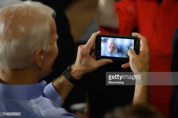 Former US Vice President Joe Biden 2020 Democratic presidential candidate takes a selfie as he greets supporters after speaking at the Teamsters...