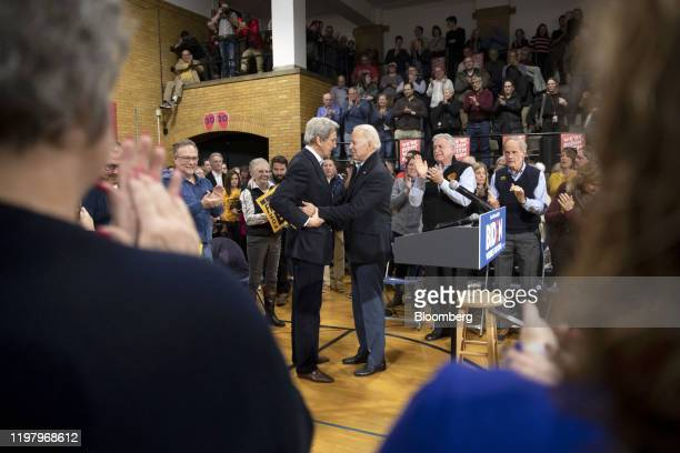 Former US Vice President Joe Biden 2020 Democratic presidential candidate left speaks with former US Secretary of State John Kerry during a campaign...