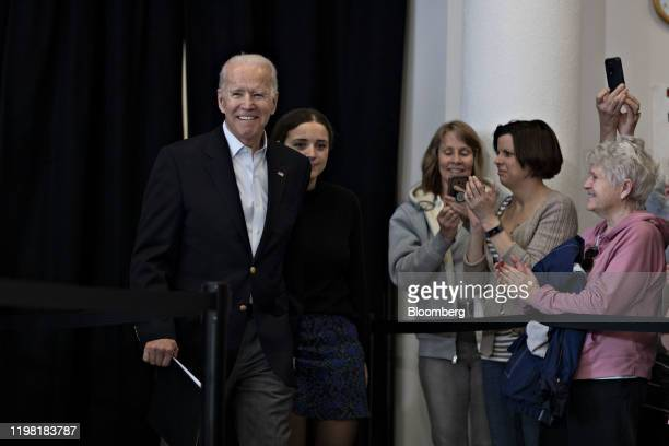Former US Vice President Joe Biden 2020 Democratic presidential candidate arrives with granddaughter during a campaign event in Dubuque Iowa US on...
