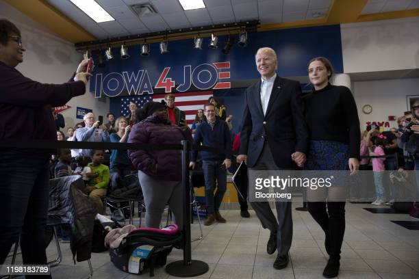 Former US Vice President Joe Biden 2020 Democratic presidential candidate arrives with his granddaughter during a campaign event in Dubuque Iowa US...