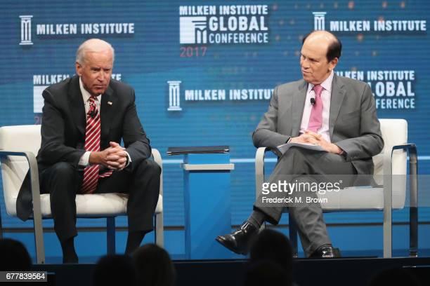 Former U.S. Vice President Joe Biden and Chairman of the Milken Institute Michael Milken speak during the Milken Institute Global Conference 2017 at...
