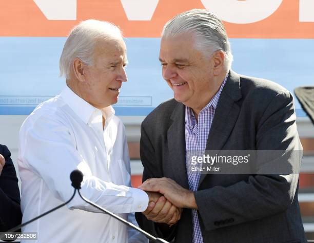 Former US Vice President Joe Biden greets Clark County Commission Chairman and Democratic gubernatorial candidate Steve Sisolak during a rally at the...