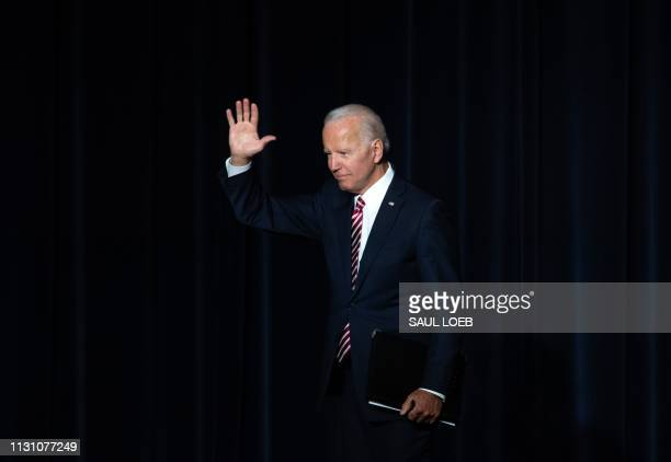 Former US Vice President Joe Biden waves to the crowd after speaking at the First State Democratic Dinner in Dover Delaware on March 16 2019
