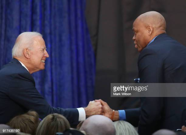 Former US Vice President Joseph Biden greets Craig Robinson during the official portrait unveiling of former US President Barack Obama and first lady...