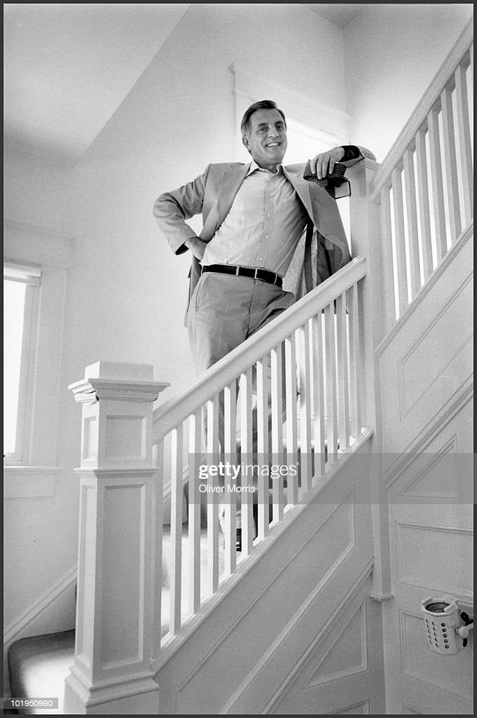 Former US Vice President Walter Mondale smiles as he stands on a staircase in his home, Washington DC, 1983.