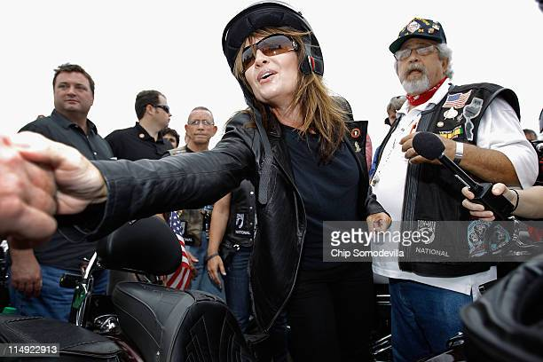 Former US Vice presidential candidate and Alaska Governor Sarah Palin greets some of the thousands of motorcycle enthusiasts and military veterans...