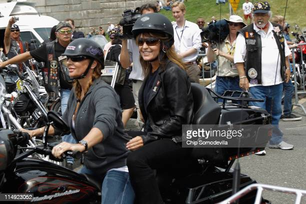 Former US Vice presidential candidate and Alaska Governor Sarah Palin rides on the back of a motorcycle before participating in Rolling Thunder rally...