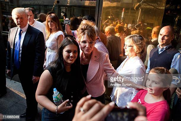 Former US Vice presidential candidate and Alaska Governor Sarah Palin takes a picture with supporters while Donald Trump left waits after leaving...