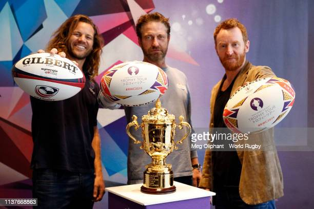 Former USA Eagles captain Todd Clever Gerard Butler and Tony Curran pose for photos with The Webb Ellis Cup during day two of the Rugby World Cup...