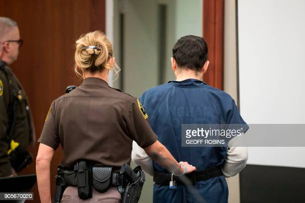 Former USA Gymnastics doctor Larry Nassar is led away following his sentencing hearing in Lansing Michigan January 16 2018 Victims of sexual abuse by...