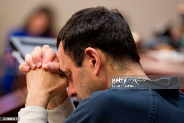 Former USA Gymnastics doctor Larry Nassar listens as victims give their impact statement during his sentencing hearing in Lansing Michigan January 16...