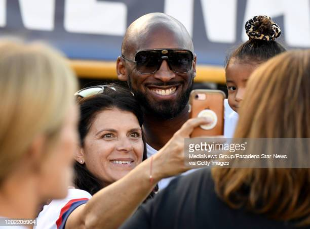 Former USA soccer player Mia Hamm poses for a photo with former Los Angeles Lakers Kobe Bryant prior to a victory tour women's friendly soccer match...