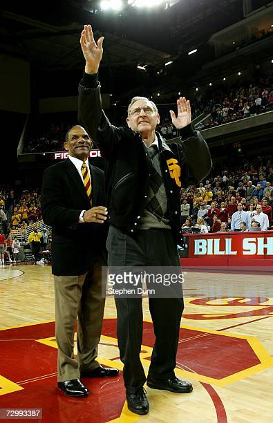 Former USC basketball player and Basketball Hall of Fame NBA player and coach Bill Sharman waves to the crowd after being presented with a USC letter...