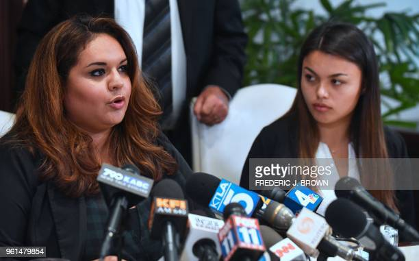 Former USC student Angela Esquivel Hawkins speaks as current University of Southern California student Daniella Mohazab watches at a press conference...