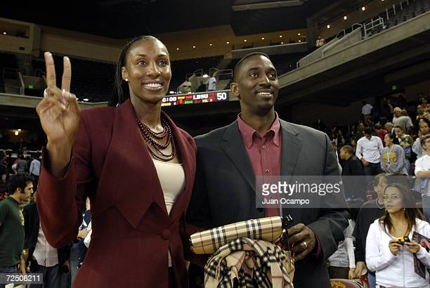 Former USC Trojan Lisa Leslie and husband Michael Lockwood after a halftime ceremony to retire Leslie and Cheryl Miller's jerseys at the newly opened...