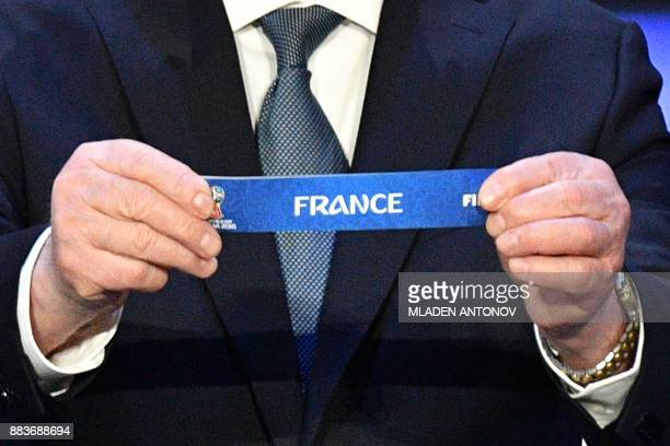 Former USSR forward and coach Nikita Simonyan displays the slip of France during the Final Draw for the 2018 FIFA World Cup football tournament at...