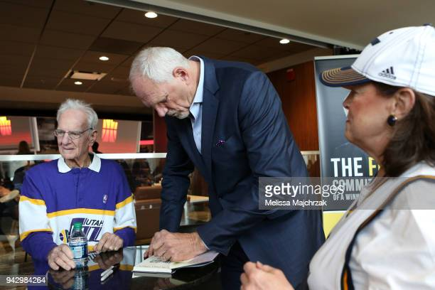 Former Utah Jazz player Mark Eaton autographs his book before the game against the Los Angeles Lakers on April 3 2018 at vivintSmartHome Arena in...