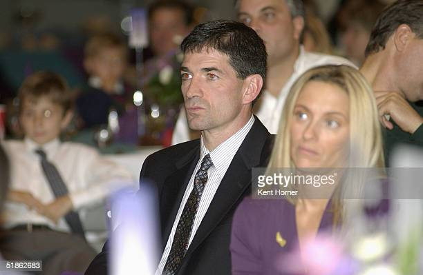 Former Utah Jazz point guard John Stockton and his wife Nada listen to a speaker at a dinner for Stockton's jersey retirement November 21 2004 at the...