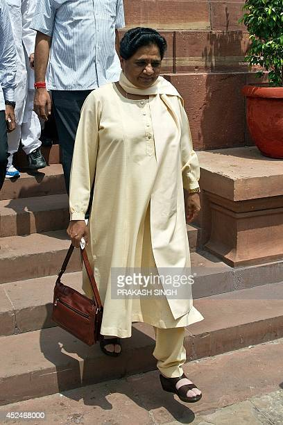 Former Uttar Pradesh Chief Minister Mayawati leaves the Parliament in New Delhi on July 21 2014 Indian parliament is set to discuss the violence and...