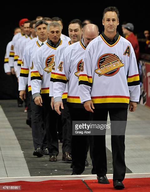 Former Vancouver Canuck Greg Adams leads members of the 1993/94 Vancouver Canucks Team into the stadium at the 2014 Tim Hortons NHL Heritage Classic...