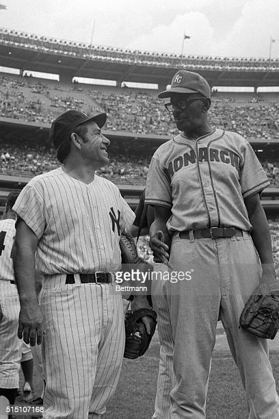 Former veteran Yankee catcher Yogi Berra stands with Satchel Paige , famed pitcher for the former Negro League's Kansas City Monarchs elected to the...