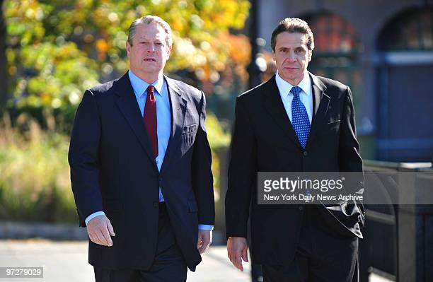 Former Vice President Al Gore and Attorney General Andrew Cuomo arrive at a press conference to announce an agreement to fight global warming with...