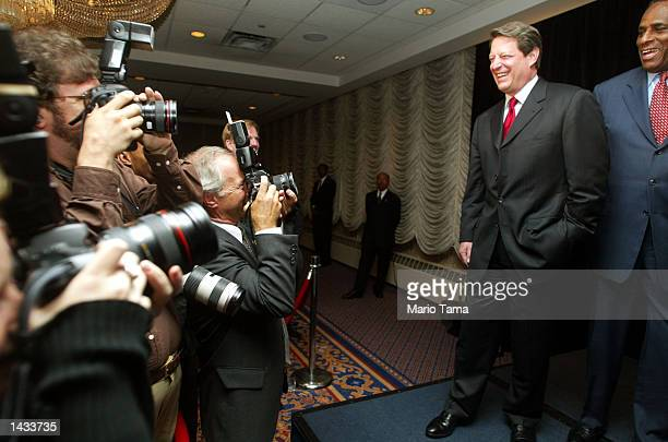 Former Vice President Al Gore and New York State gubernatorial candidate H Carl McCall laugh as photographers take photos during a McCall fundraiser...