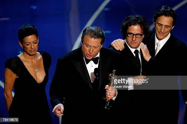 """Former Vice President Al Gore and the producers of """"An Inconvenient Truth"""" accept the award for Best Documentary Feature during the 79th Annual..."""