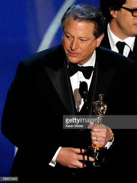 """Former Vice President Al Gore and the producers of """"An Inconvenient Truth"""" accepts the award for Best Documentary Feature during the 79th Annual..."""