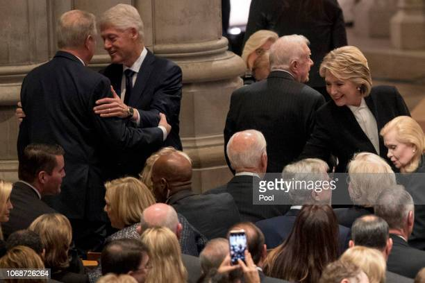 Former Vice President Al Gore left greets former President Bill Clinton second from left as his wife former Secretary of State Hillary Clinton right...