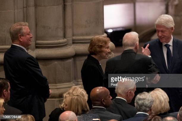 Former Vice President Al Gore left looks on as former President Jimmy Carter second from right and former first lady Rosalynn Carter third from right...