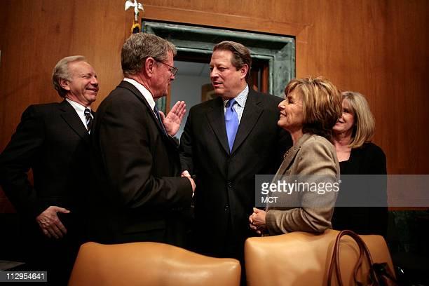 Former Vice President Al Gore talks with Sen James Inhofe Chairman Barbara Boxer Sen Joe Lieberman before testifying on Capitol Hill in Washington...