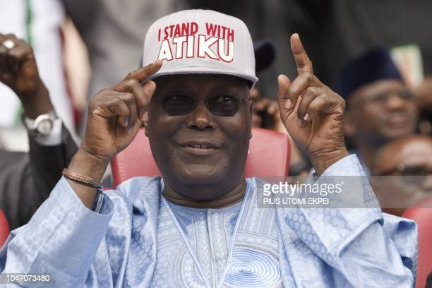 Former Vice President Atiku Abubakar raises his hands in victory after he won the presidential ticket of the opposition People's Democratic Party...