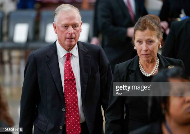 Former Vice President Dan Quayle and his wife Marilyn Quayle arrive at the US Capitol Rotunda on December 03 2018 in Washington DC A WWII combat...