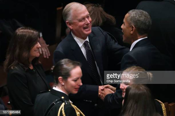 Former Vice President Dan Quayle greets former President Barack Obama during the state funeral for former President George HW Bush at the National...