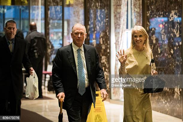 Former Vice President Dan Quayle walks with Trump campaign manager Kellyanne Conway as they arrive at Trump Tower November 29 2016 in New York City...