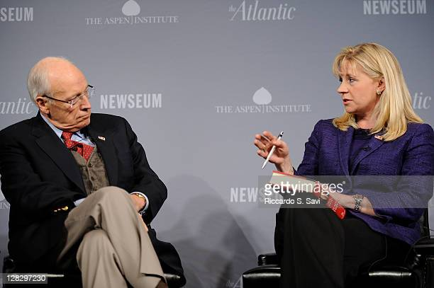 Former Vice President Dick Cheney speaks with Liz Cheney at the 2011 Washington Ideas Forum at The Newseum on October 6 2011 in Washington DC